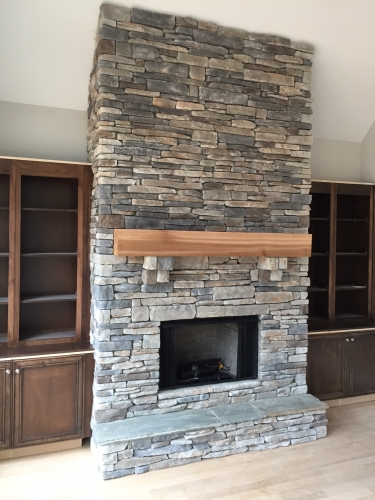 Home Interior Services - Earth Concepts Contracting - cultured-stacked-stone-fireplace